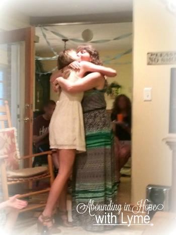 Mom hugging Graduate