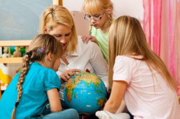 Mom teaching her kids with a globe